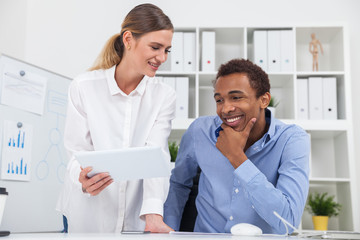 Man and woman working at project together