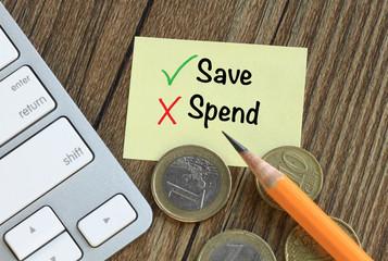 concept of saving versus spending