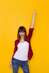 Smiling Woman Showing Victory Hand Sign