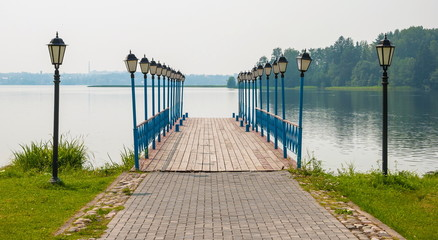 Pier on the lake is decorated with lanterns
