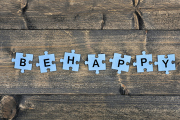 Puzzle with word Be happy