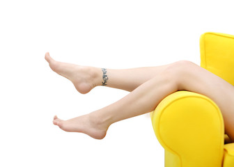 Female feet with tattoo on light background