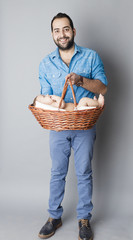 Young dad carrying his son inside wooden basket