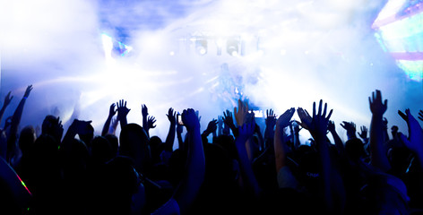 silhouettes of massive crowd at party concert club music happy
