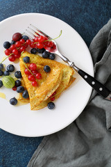 crepes with fresh berry on white plate