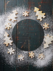 Gingerbread cookies on rustic background