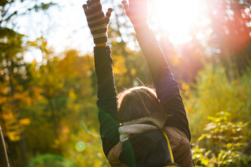 Woman raise arms up outdoor. Carefree woman.