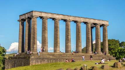 Edinburgh, Scotland - Jul 1, 2014 : People are spending their holiday around the National Monument on the Calton Hill on the sunny day, at Edinburgh city, Scotland.
