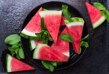 Watermelon slices on a grunge table