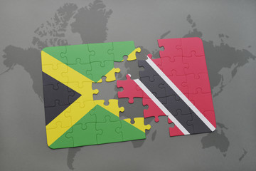 puzzle with the national flag of jamaica and trinidad and tobago on a world map background.