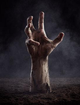 Dirty male hand on dark background