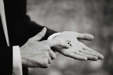 two wedding rings on groom's palm