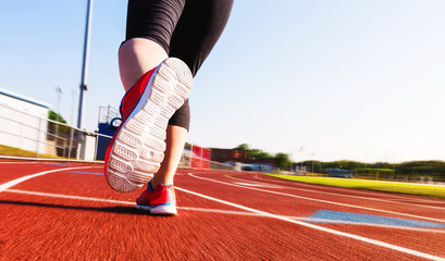 Woman jogging on a running track