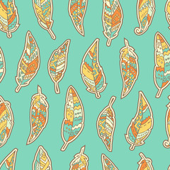 Seamless pattern with hand drawn ornate feathers on blue background.