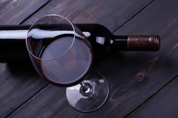 Red wine on dark wood