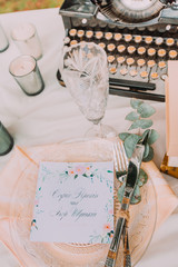 Wedding table decoration with classic typewriter wand roses and candles