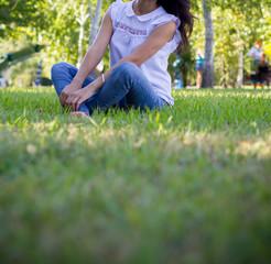 Teen girl siting on grass