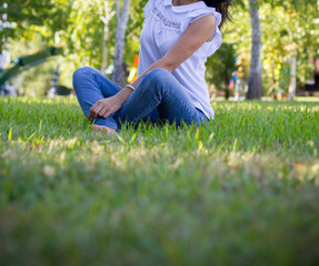 Teen girl siting on grass