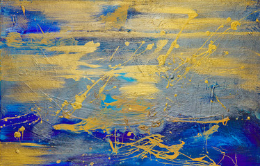 gold oil paint smeared on blue canvas