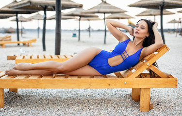 Beautiful girl in a sexy blue swimsuit