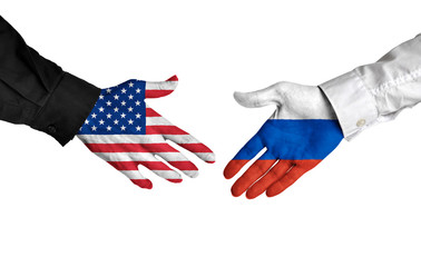 United States and Russia leaders shaking hands on a deal agreement
