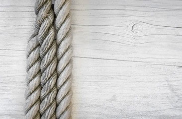 Wooden planks with rope background