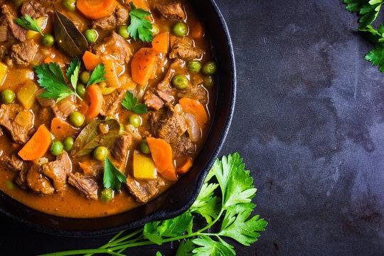 beef stew with vegetables on dark background