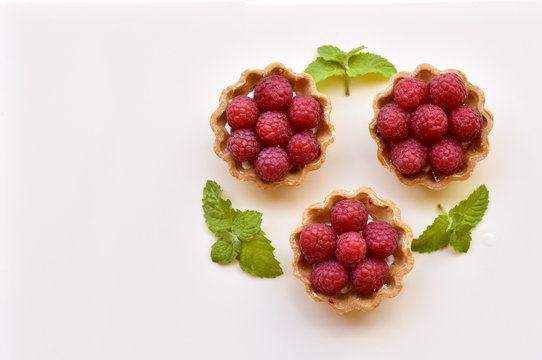 Fruit raspberry tart cakes with copy space for text