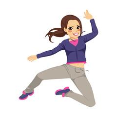 Beautiful brunette sporty dancing girl jumping