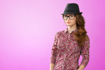 Beautiful, naturall girl in a hat and glasses