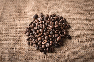 Coffee beans on sackcloth background