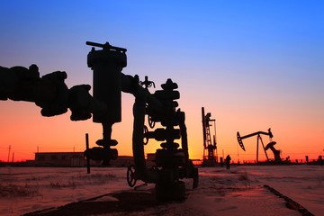 In the evening of oilfield pipeline silhouette
