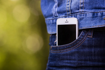 Smartphone in everyday life. phone in jeans pocket.