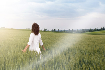 Pensive man striding through agriculture field in nature