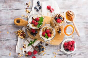 Healthy breakfast - homemade granola adn fresh berries, top view