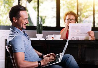 Man sitting and using laptop