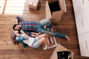 Happy couple on wooden floor in new kitchen