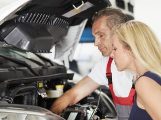 Female customer and mechanic