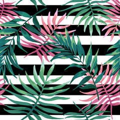 Palm leaves and fern on a black stripes.