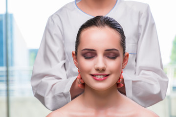 Young woman during face and skin massage session