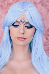 Portrait of cute girl with beauty makeup and blue hair wig.