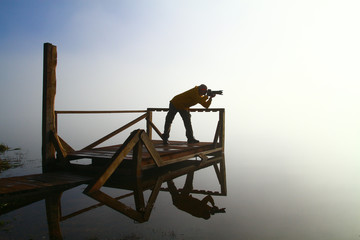 Male nature photographer in action