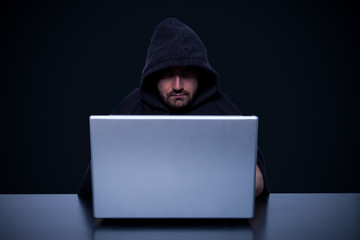 Hacker in front of his computer monitor