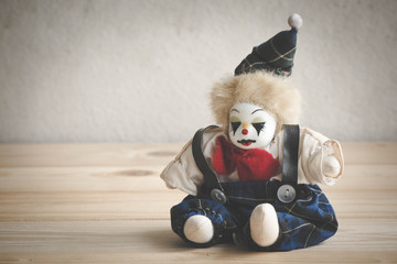 Vintage retro picture style - Jester doll on wood table