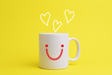White coffee cup with smiley face