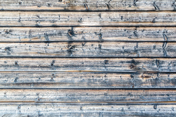 Close up of old worn log house wall outdoors.