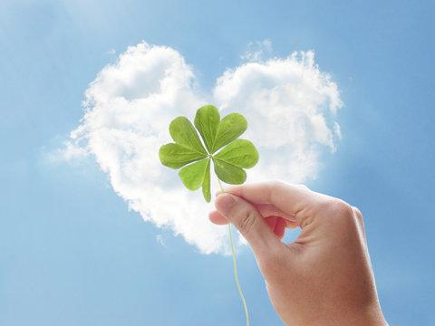 holding clover hand heart cloud