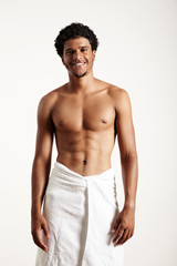 young man in white towel on a white background