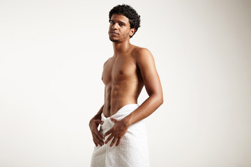 man in white towel with perfect body