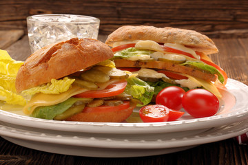 Fresh vegetarian sandwiches with tomato and cucumber on the plat